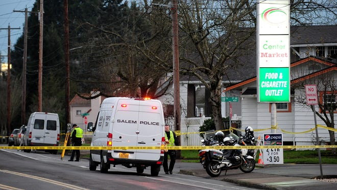 Emergency personnel respond to the scene of a fatal pedestrian crash that blocked Center Street NE between 17th and Statesman streets NE on Thursday, January 15, 2015, in Salem.