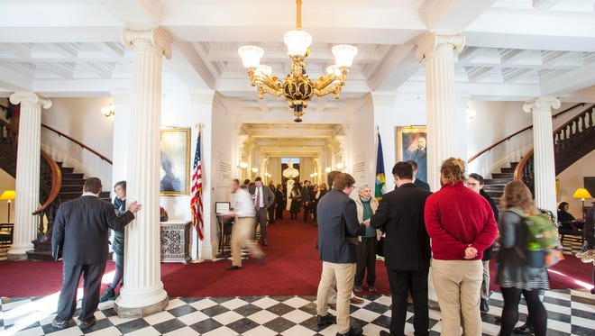 People fill the halls of the State House on the opening day of the legislature in Montpelier on Wednesday, January 3, 2018.