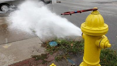 Water sprays out of a fire hydrant.