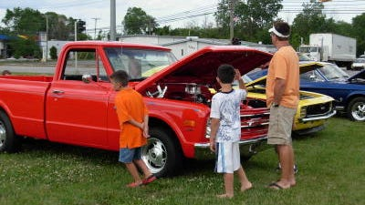 Visitors get a close-up view at some of the vehicles during a previous Cruizin Car and Truck Show in Flat Rock.