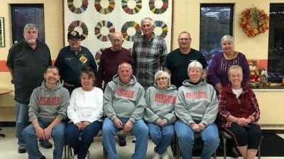 Members of the Bedford Township Goodfellows gathered in 2018 for their annual group photo for the Goodfellows newspaper sale. This year, the sale will be held on the first two weekends in December. Shown are (front row, from left) Secretary Curtis Vickre, Angie Cumpian, Lou Strauss, Ellen Strauss, Sue Carey and Doris Matthews; (second row, from left) Bob Carey, John Andres, Charlie Maenle, Vice President George Kreft, President Chris Knaggs and Fran Popek.