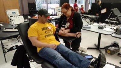 """Joy Wright, a registered nurse employed by the American Red Cross, preps the arm of Jack Pizzo of Monroe during a blood drive in January at Monroe County Community College. Pizzo, 48, donated a pint of blood for the first time, saying it was for a """" good cause."""" Wright is an Army veteran who lives in Dundee."""