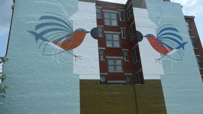 "ArtWorks'  Downtown mural is a tribute to Cincinnati wildlife artist Charley Harper. ""Homecoming (Bluebirds)"" is at 119 E. Court St.."