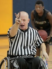 Joe Slaski calls a two-shot foul as he referees a modified boys basketball game in Webster between Webster Willink Middle School and Rush-Henrietta Burger Middle School on Tuesday. Slaski is the only basketball referee in Section V who works from a wheelchair.