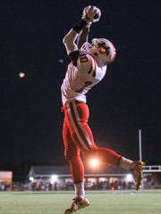 Palmetto's Antwuan Thurmond (10) catches a pass for his second touchdown against Crescent during the second quarter against Crescent last week.
