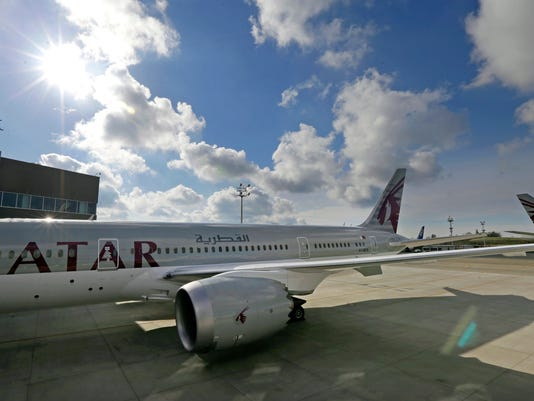 FILE - In this Wednesday, Nov. 4, 2015 file photo, the 24th Boeing 787 airplane purchased by Qatar Airways is photographed, during a delivery ceremony in Everett, Wash. FIFA has signed up Qatar Airways as a sponsor through 2022 when the World Cup is staged in the Gulf nation. (AP Photo/Ted S. Warren, File)