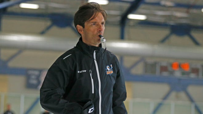 San Diego Gulls coach Dallas Eakins watches during hockey practice, Thursday, Oct. 8, 2015, in San Diego.