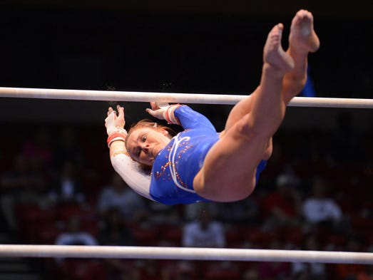 April 20, 2014; Birmingham, AL, USA; Florida gymnast Bridget Sloan competes on bars during the NCAA Gymnastics Individual Event Finals at the BJCC Arena. Sloan won the event with a score of 9.9375.