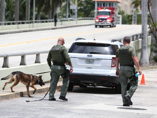 Authorities search Dayonte Resiles after he escaped from the Broward County Courthouse, Friday, July 15, 2016, in Fort Lauderdale, Fla. Resiles, who was awaiting trial for the slaying of a woman whose family founded the Halliburton oil services company, slipped out of his shackles and bolted from a courthouse Friday just before a hearing on whether he could face the death penalty.