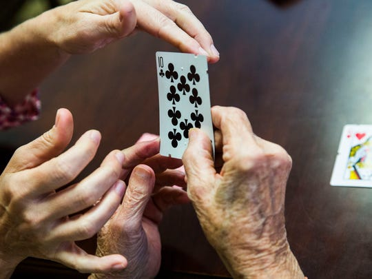 A group at Lighthouse of Collier Inc. in Naples plays a game of cards on Thursday, Feb. 9, 2017. Bill Blauvelt, 68, created playing cards for the blind or visually impaired. The cards have ridges along the side that communicate what the suit and number of the card is.