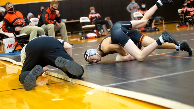 Augusta's Andy Lin (on top) wrestles Andover Central's Jason Newcomb on Thursday, Dec. 3 at Augusta High School
