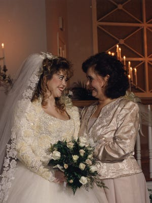 Peggy Gilmer, right, with her daughter, Holly, on her wedding day. Peggy made Holly's wedding gown over the course of nine months.