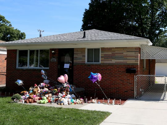 A memorial of flowers, stuffed animals and candles crowd the front porch area of the Green home on Hipp Street in Dearborn Heights on Thursday, September 22, 2016.