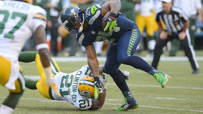 Green Bay Packers safety Ha Ha Clinton-Dix (21) tries to tackle Seattle Seahawks running back Marshawn Lynch during their game at CenturyLink Field in Seattle last September.