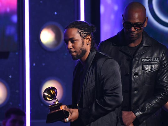 Kendrick Lamar picks up his award for best rap album from Dave Chappelle  during the 60th Annual Grammy Awards at Madison Square Garden.