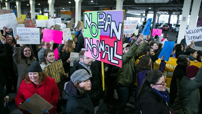 Thousands of protesters crowd Philadelphia International Airport Sunday to speak out against the president's temporary ban on refugees from seven Muslim-majority countries.