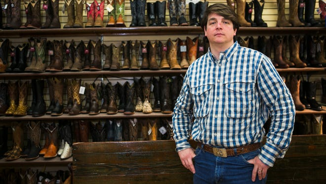 "February 14, 2017 - Charles Hall, a partner at Hewlett & Dunn Jean & Boot Barn, stands in a room at the Collierville business on Tuesday. Hall voted for freshman state House Representative Mark Lovell, who has submitted his letter of resignation amid allegations he had inappropriate sexual contact with a woman last week. ""He said the right things and my experience with Curry Todd was he didn't exactly do the right things, and it's a shame that Mark Lovell's no different,"" Hall said."