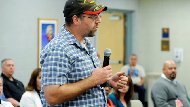 Hyde Park resident Jeff Wynans, a U.S. Army combat veteran of the war in Afghanistan, asks a question about services during a town hall-style meeting on Tuesday at the VA Hudson Valley Healthcare System's Castle Point campus.