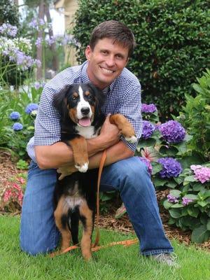Scott Baehr with his dog, Sheba.