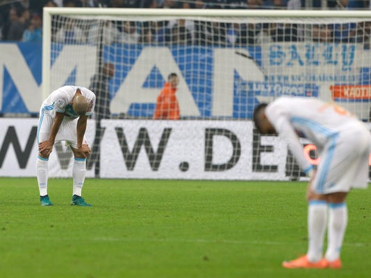 Marseille's Brazilian defender Matheus Doria Macedo, left , and Marseille's midfielder Remy Cabella, react at the end of the League One soccer match between Marseille and Bordeaux, at the Velodrome stadium, in Marseille, southern France, Sunday, Oct. 30, 2016. (AP Photo/Claude Paris)