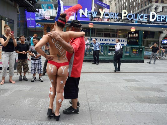 US-OFFBEAT-TOPLESS-TIMES SQUARE