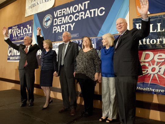 The Vermont congressional delegation, from left, Rep. Peter Welch, D-VT, his wife Margaret Cheney, Sen. Bernie Sanders. I-VT, and wife Jane Sanders, Marcelle Leahy and her husband, Sen. Patrick Leahy, D-VT, greet Democrats in 2014. Welch recently endorsed Sanders' presidential bid, while Leahy has endorsed Sanders' rival, Hillary Clinton.