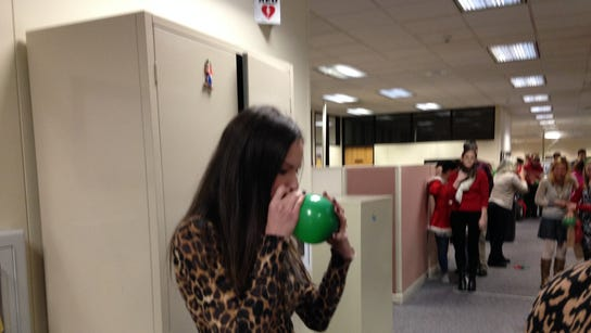 Team members took turns blowing up balloons for the