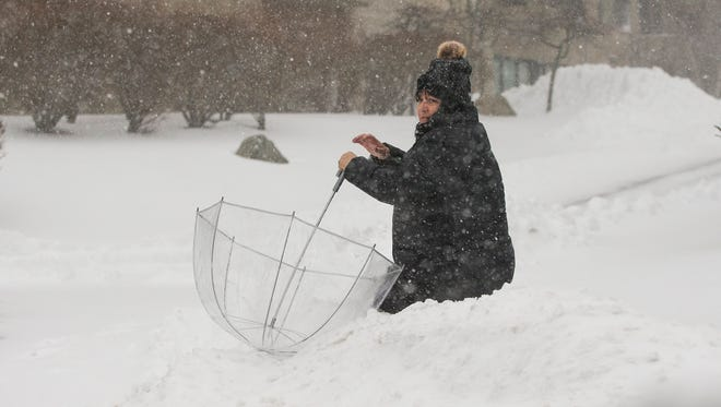 A woman struggles in the deep snow in Revere, Mass. on Jan. 4, 2018.