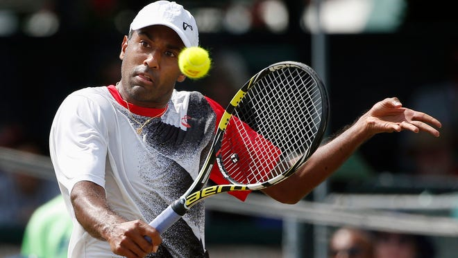 Rajeev Ram returns against John-Patrick Smith, of Australia, during a Tennis Hall of Fame Championship semifinal match in Newport, R.I., Saturday, July 18, 2015.
