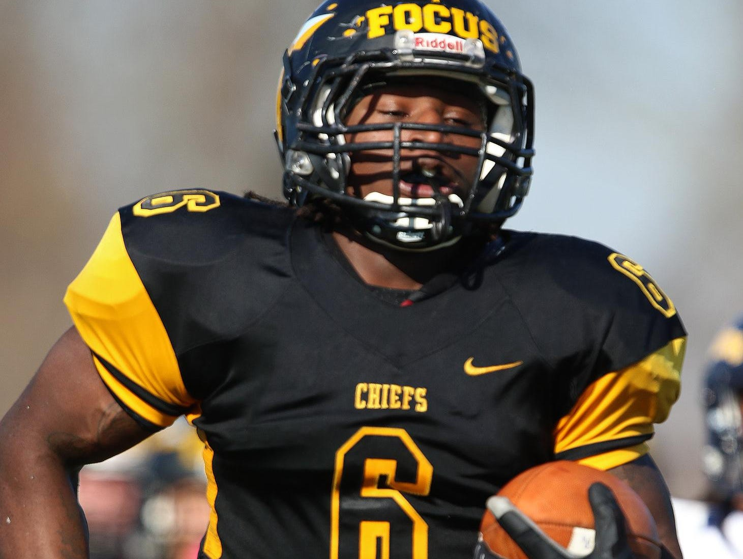 Piscataway football's Zaire Ashley runs in for a touchdown against Ftra.