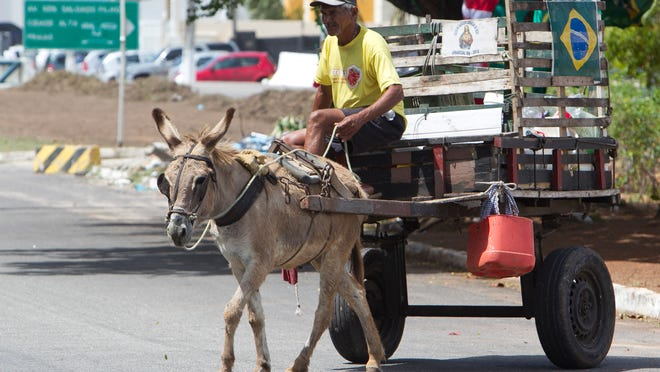 A man uses an older method of getting around Natal, Brazil. The city will be hosting a World Cup soccer match between the United States and Mexico.