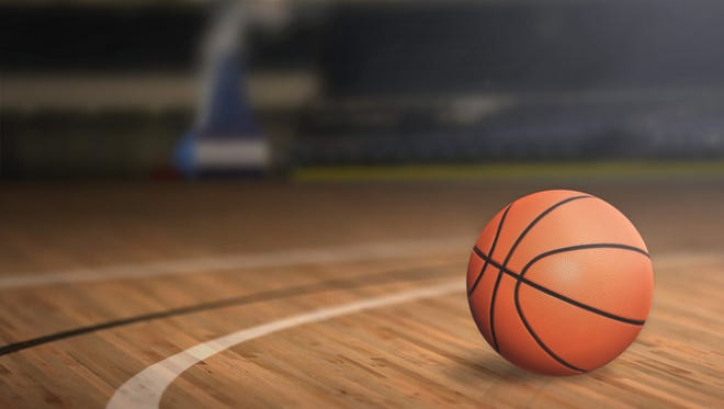 a close up of a basketball on a court floor, blurred out bokeh background