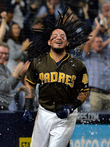 Sept. 28: San Diego Padres shortstop Freddy Galvis (13) celebrates after hitting the game-winning RBI double in the 15th inning against the Arizona Diamondbacks.