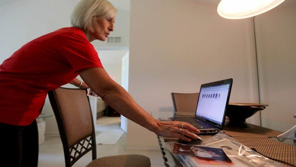 Sydney Zaremba, of Rochester, Mich., looks over images of her mother Helene Zaremba on the computer at her home on Monday Sept. 9, 2013.