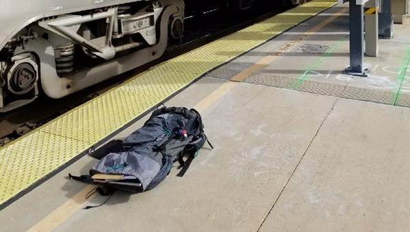 An Amtrak train was evacuated in Moorpark Saturday morning. Gear carried by a man who boarded suddenly and behaved oddly before locking himself in the bathroom worried train personnel and passengers.