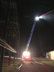 Aerial tower truck pours water in the DTE substation.