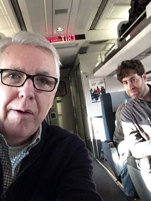 Columnist Michael Kelly and staff photographer Kevin R. Wexler on a train to Washington D.C. for Trump's inauguration.