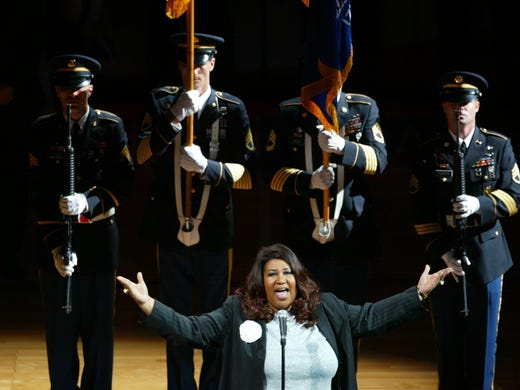 Aretha Franklin sings the national anthem prior to