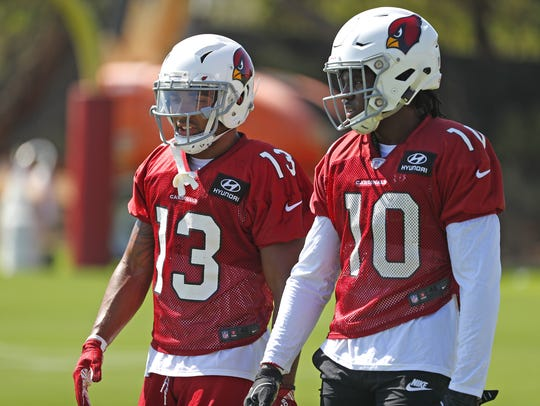 Christian Kirk and Chad Williams talk during a Cardinals practice in Tempe on Aug. 19.