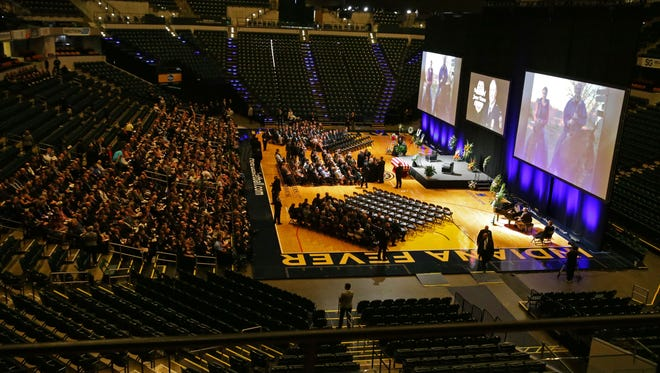 Family, friends and fellow IMPD officers arrive for the funeral of IMPD Deputy Chief Jim Waters at Bankers Life Fieldhouse in Indianapolis on Wednesday August 2, 2017.