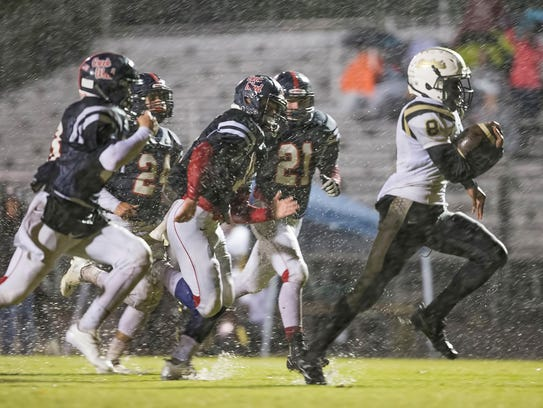 Springfield running back Keith Jones (8) is pursued