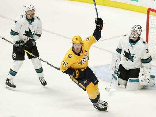 Nashville Predators center Ryan Johansen (92) celebrates after teammate Ryan Ellis (not shown) scored a goal against San Jose Sharks goaltender Martin Jones (31) in the third period of an NHL hockey game Thursday, March 29, 2018, in Nashville, Tenn. Sharks left wing Paul Martin (7) looks on. (AP Photo/Mark Humphrey)