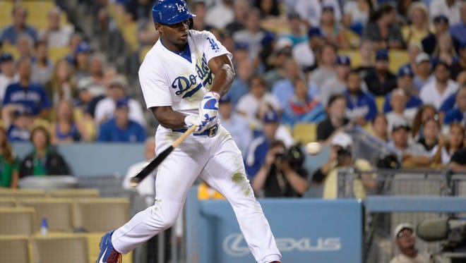 Los Angeles Dodgers right fielder Yasiel Puig hits a single against the Oakland Athletics during the seventh inning at Dodger Stadium.