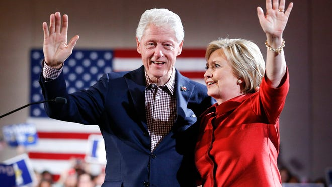 Democratic presidential candidate Hillary Clinton, right, waves on stage with her husband and former President Bill Clinton for a Nevada Democratic caucus rally, Saturday, Feb. 20, 2016, in Las Vegas.