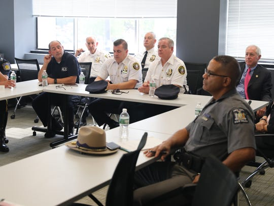 Local law enforcement personnel attend a community outreach program given by  lohud.com drone pilots Ricky Flores and Peter Carr, at The Journal News offices in White Plains, New York, Sept. 12, 2017.