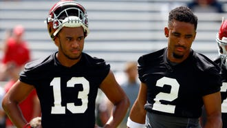 Alabama quarterback Tua Tagovailoa stands next to Jalen Hurts (2) during the team's practice this month.