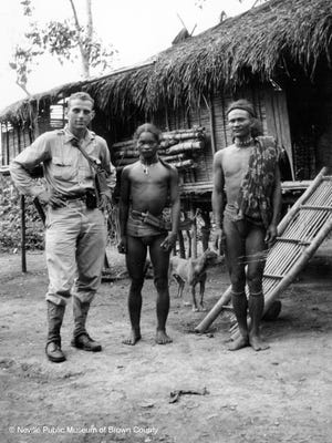 Austin Straubel with two members of the Ilingot tribe  in the Phillipines.