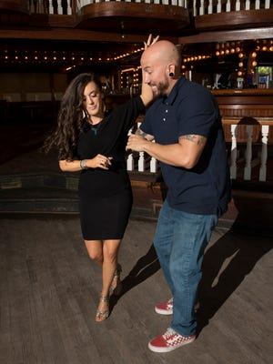 Dance instructors Hannah Marshall and Gene Morales show off some moves before teaching class during the weekly Latin Dance night at Seville Quarter in Pensacola on Wednesday, April 4, 2018.
