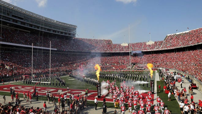 The Ohio State football team takes the field for a game against the Miami Redhawks on Sept. 21 in Ohio Stadium.