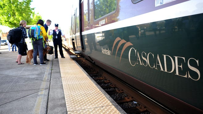 Passengers wait to board the Amtrak Cascades, on Sunday, at the Salem station. There may not be enough money in the state budget to keep the train running between Eugene and Portland.